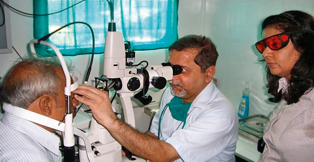 A local ophthalmologist receives hands-on training inside the mobile truck. INDIA