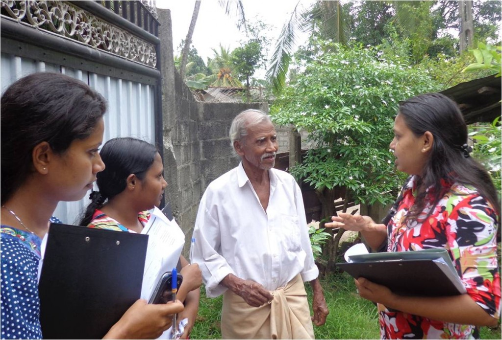 Enumerators explaining the national survey of visual impairment and blindness to a participant in Sri Lanka