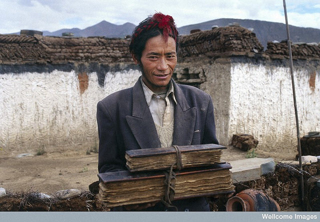 A Tibetan doctor holding his family's medical texts (Theresia Hofer, Wellcome Images: https://www.flickr.com/photos/wellcomeimages/14933009688/)