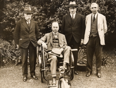Ross in wheelchair with Sir William Simpson and Sir Aldo Cas