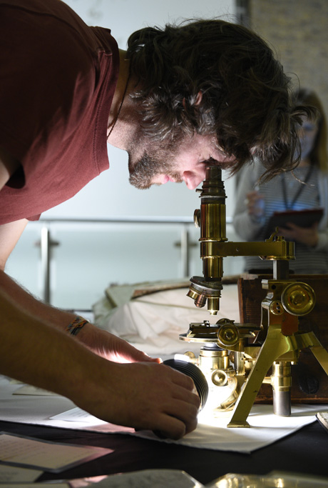 Sir Ronald Ross' microscope fixed by visiting academic during Ross Slides Under the Microscope event