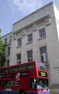 LSHTM building Gower Street corner with a red bu[1615]